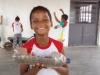 estudante-feliz-pela-reciclagem-da-garafa-pet-e-cultivo-da-horta-escola-bolivar-santana-juazeiro-ba